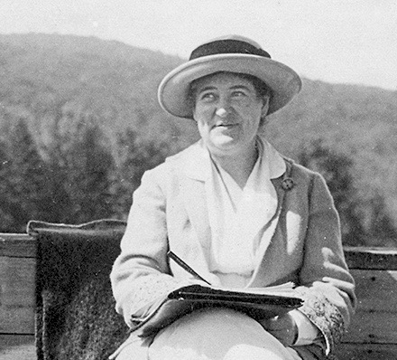 Willa Cather writing at  Shattuck Inn with Mt. Monadnock in background. Photo attributed to Edith Lewis.