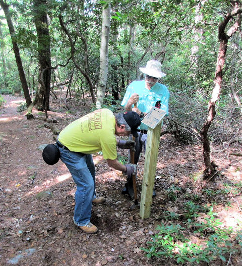 Rodger and Denny installing the winning poems at Cathedral of the Pines. Photo and supervision by Carl.